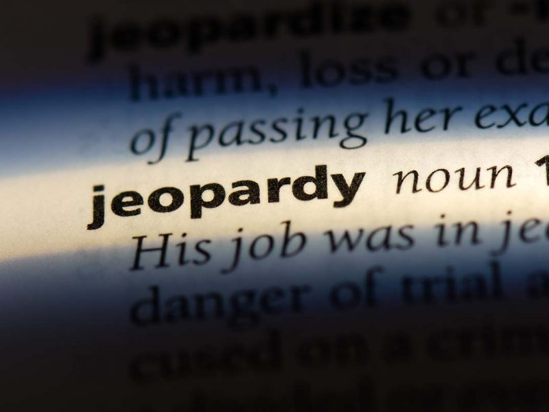"""The word """"Jeopardy"""" in a blurred page in a book"""