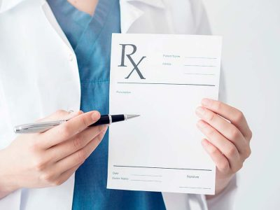 Doctor pointing on RX prescription