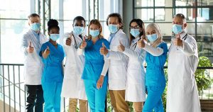 doctor-group-wearing-masks-giving-thumbs-up
