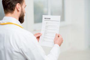 Doctor reading resume for job hiring in the hospital