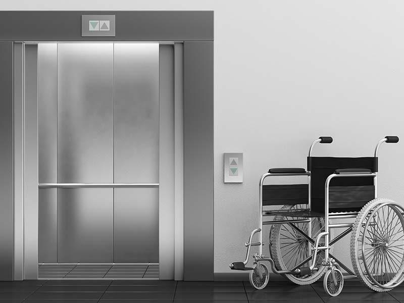 Open Elevator Doors with a wheel chair in front of doors