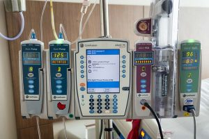 patient monitoring and Intravenous equipment in a modern hospital room. This equipment monitors and regulates a variety of medication
