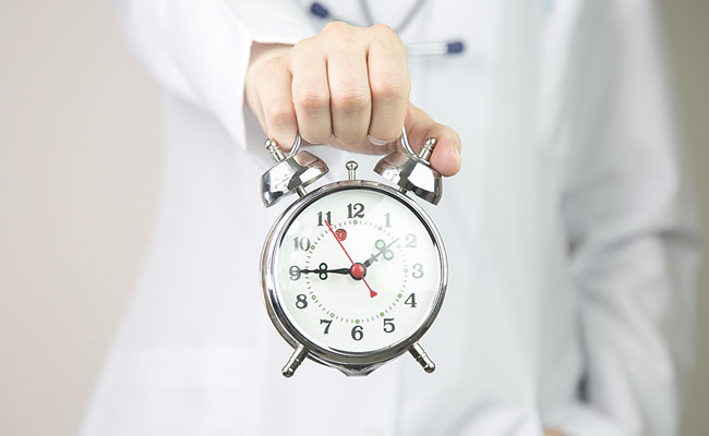Medical background doctor with clock.